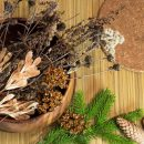 Christmas and New Year decorations. Dry branches, cones, fir branch. Warm tones.
